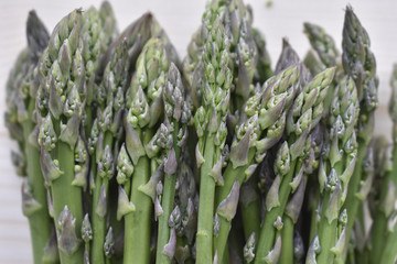 Fresh Biologic Asparagus on Wooden Background