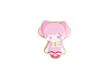 Cute cookie isolated on a white background. Gingerbread with sugar glazed of a little girl in pink with pigtails, very cute Japanese style lolita dress.