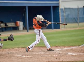 Baseball player swinging at the ball