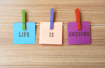 Life is awesome Inspirational quote on notes hanging by clothespins