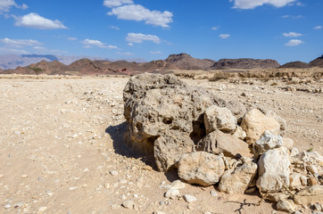 Volcanic bomb in geological Timna park, it is located 25 km north of Eilat (Israel), combines beautiful scenery with unique geology, variety of sport and family activities