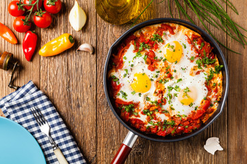 Photo Stands Ready meals Shakshouka, dish of eggs poached in a sauce of tomatoes, chili peppers, onions