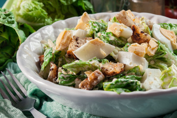 Healthy caesar salad with cheese, eggs and croutons