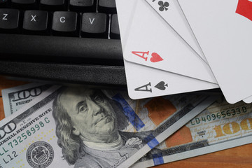 virtual casinos, real money. keyboard, dollar and playing cards