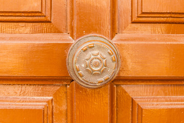 close up on a round door handle with decorative elements, door decoration