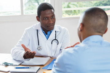 African american doctor explaining diagnosis to patient
