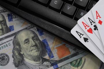 virtual casinos, real money. keyboard, dollar and playing cards
