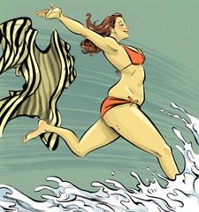 Plus size woman at beach