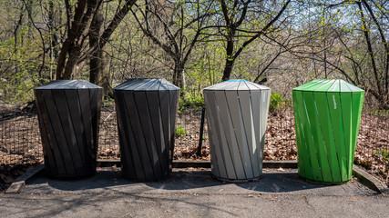 Colorful Metal trash bins in the park