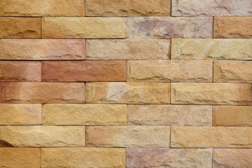 Sandstone wall texture closeup for background.