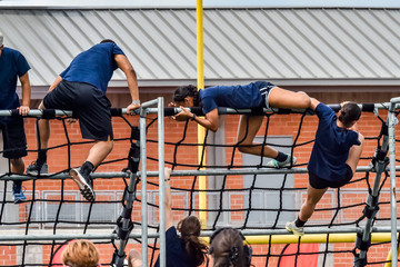 Athletes competing on an obstacle course