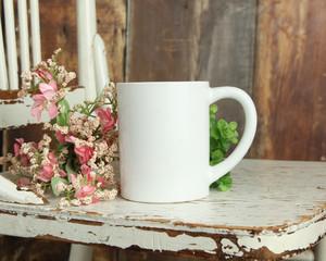Blank white mug mockup photo with rustic wood background