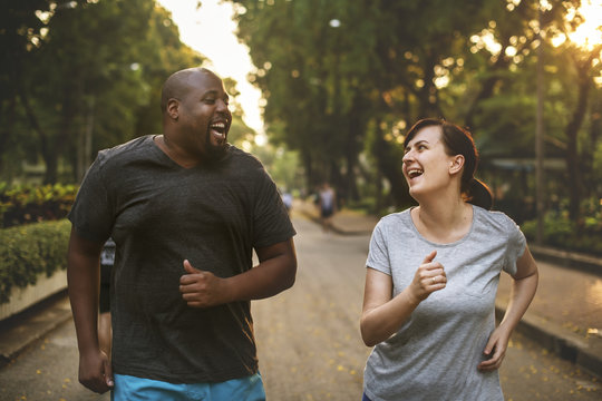 Man and woman running in park