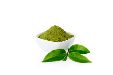 Powder green tea and green tea leaf isolated on white.