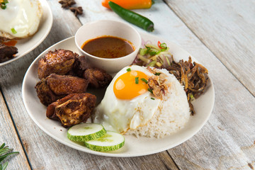 malaysian fried chicken rice with anchovies and egg