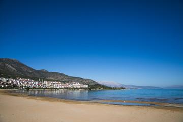 tranquil landscape with buildings on coast, salda golu, turkey