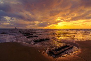 Golden sunset on Crosby Beach, Liverpool, England, UK