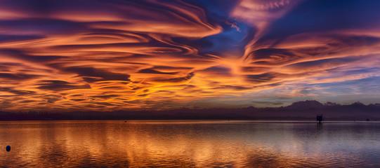 Aluminium Prints Heaven Amazing lenticular clouds at the sunset