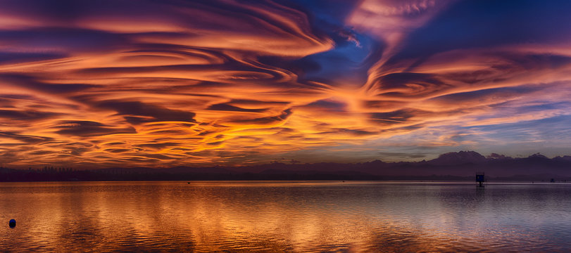 Amazing lenticular clouds at the sunset