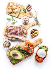 Variety of popular Italian food on white background. Top view.