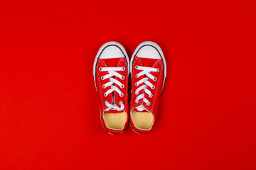 Red sneakers top view close up on colorful background