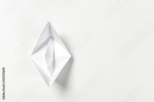 Origami Paper Boat Isolated On White Background Stock Photo And