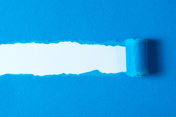 Torn blue paper with ripped edges for background