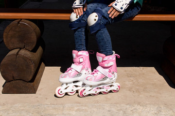 Girl on roller skates . The concept of a healthy lifestyle
