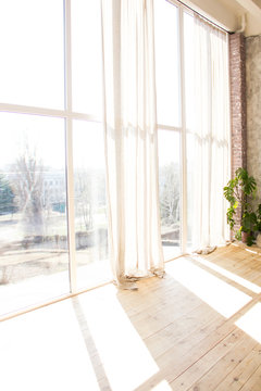 panoramic light windows in the interior with white clothes in sunny day