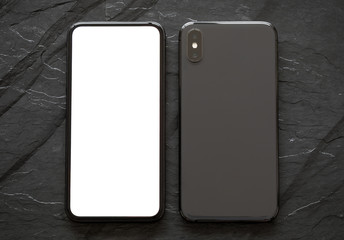 Mobile phone on black stone surface, front and back