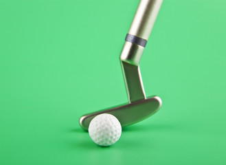 golf club with a ball on a green background