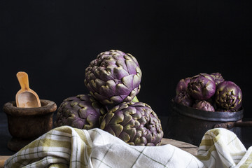 Fresh artichokens on dark