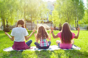 Three young girls doing yoga