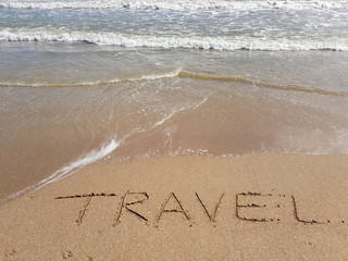the word travel written on the sand, nobody.