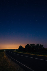 Landscape with highway and starry sky