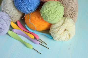 Colorful yarn and hooks for knitting. Close-up. Copy space.