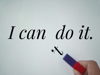 Conceptual - 'I can do it' written on a white paper with a letter 't' being pulled away from can. Vintage styled background.