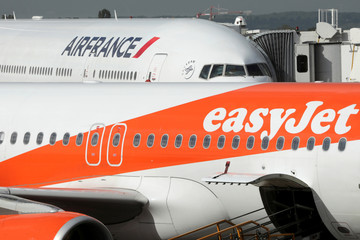 An EasyJet airplane and an Air France airplane are seen on the tarmac at Orly airport near Paris, France, as Air France pilots unions continue strike action