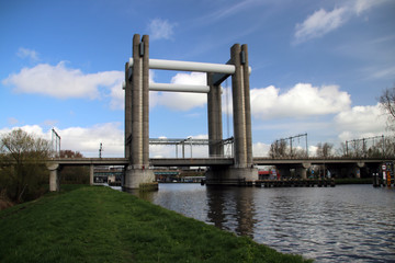 vertical lift bridge for trains in Gouda over canal named Gouwe in the Netherlands