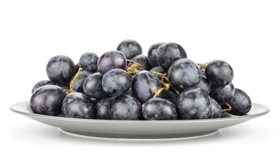 Black purple grape cluster (autumn royal variety) on a grey plate isolated on white background.