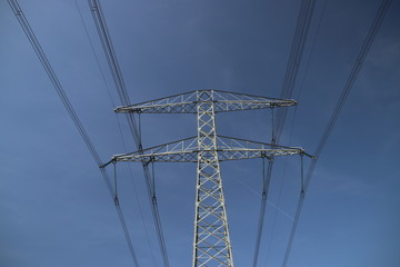 Powerlines with blue sky in close-up above the Hennipgaarde in Zevenhuizen, the Netherlands