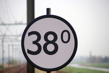 Crossway sign at a railroad track in the Netherlands, when trains is passing this sign, at 38Km the crossway will be closed