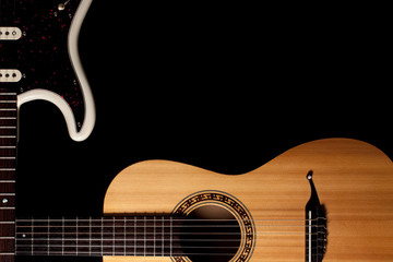 Guitars music image with copy-space. Crossed electric and acoustic guitar