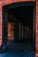 Dark gallery of the old house from a red brick