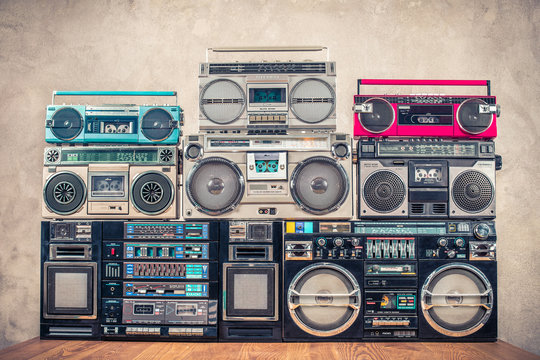 Retro old school design ghetto blaster stereo radio cassette tape recorders boombox tower from circa 1980s front concrete wall background. Vintage instagram style filtered photo