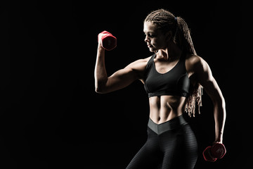 A great sport female body. The girl athlete demonstrates chiseled biceps. Miss fitness bikini