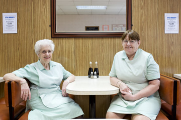 Portrait of two waitresses in diner