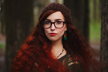 red haired girl in the forest