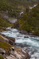 Aluminium Prints New Zealand View of canyon with a fast mountain river in Folgefonna National Park in Hordaland, Norway