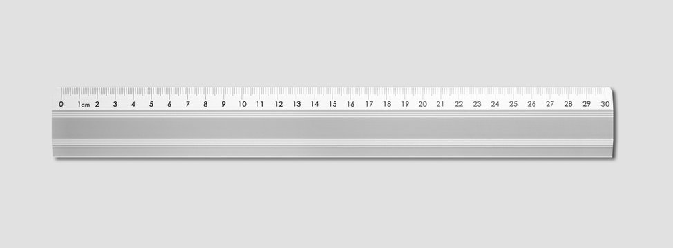 Metal ruler isolated on grey background
